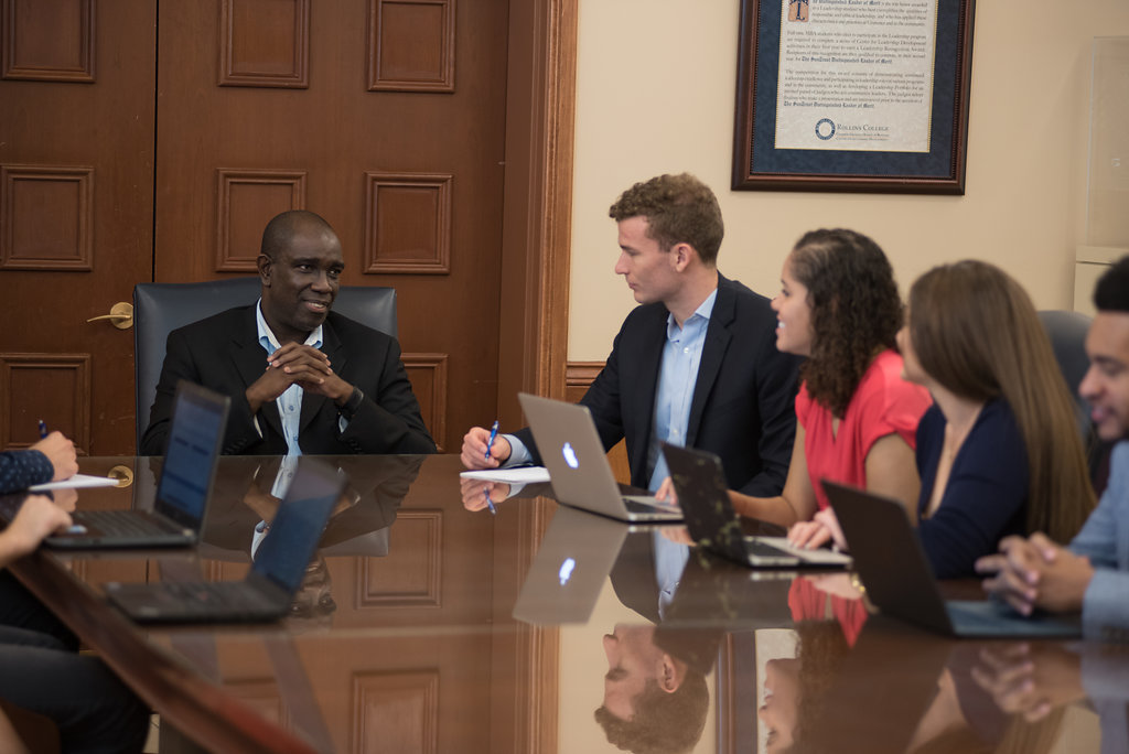 Dr. Keith Whittingham With Students in Boardroom